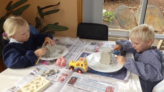 Jeremiah and Cassandra Stott carving their clay